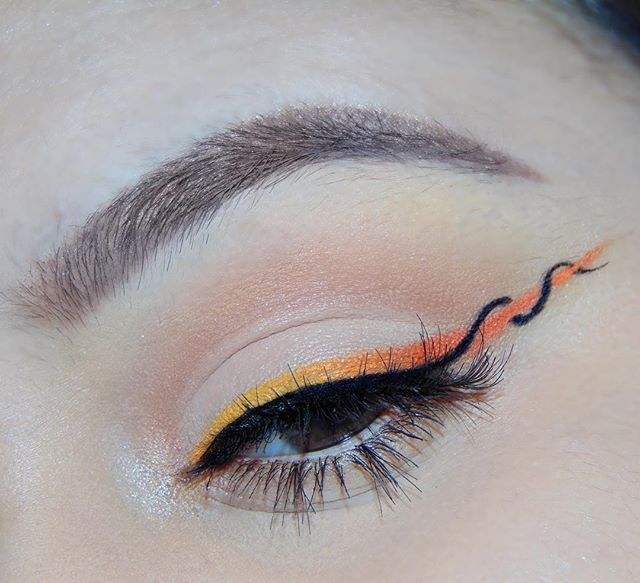 Wanted to try out the helix eyeliner trend that's been going around lately  DEETS BELOW Brows: @anastasiabeverlyhills dipbrow and brow wiz in chocolate  Lid Shadows: @morphebrushes 35O palette  Black Liner: @maybelline gel liner in Blackest Black Yellow shadow used for liner: @sephora  Collection no.215 Sunglasses Needed Orange shadows used for liner: @morphebrushes 35O oranges Lashes: @ardell_lashes  Inner corner highlight: @anastasiabeverlyhills sunburst highlighter