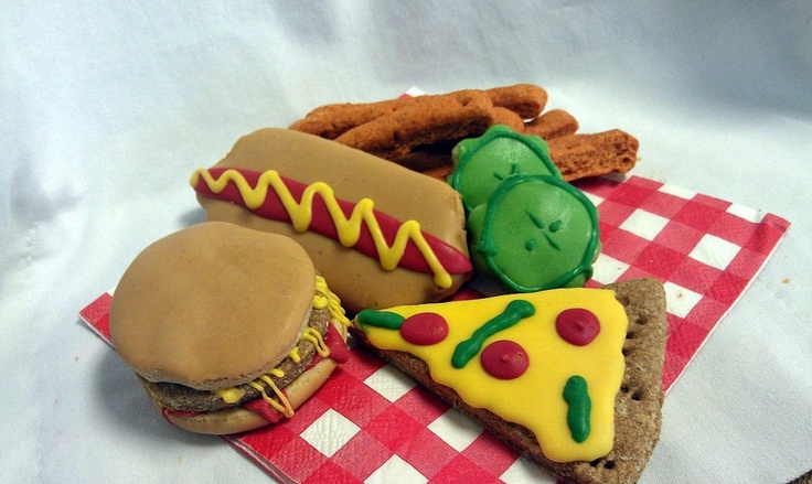 All American Basket. One pizza slice, one burger, one hotdog, fries, and two pickles!