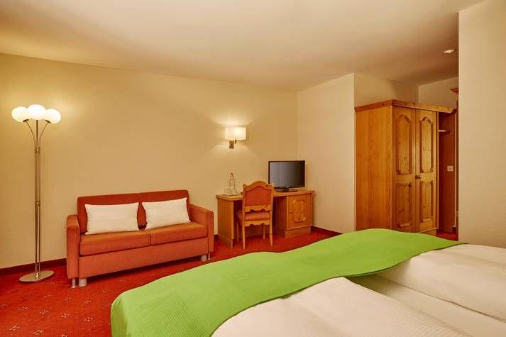 Superior Doppelzimmer mit Balkon - H+ Hotel Engelberg - Offizielle Webseite