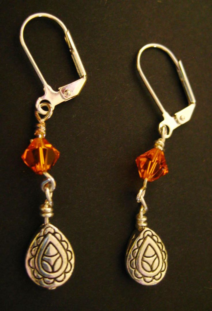 Orange Bicone & Teardrop Earrings - Orange bicone stone and silver-plated teardrop shaped drops. Leverback style earring hooks.  $2.99 available at http://www.beaddesignsbysandy.com/shop/clearance-items/