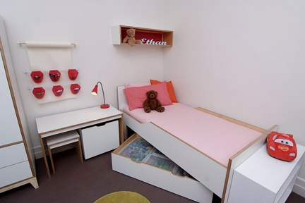 Maximise storage with wall and floor shelving, underbed drawers and toy boxes that fit under the desk.  http://www.kidsindesignedspaces.com.au/residential/juniorproject1