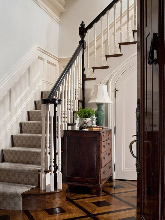 stairs with gray beige runner... because it is darker it anchors the room.