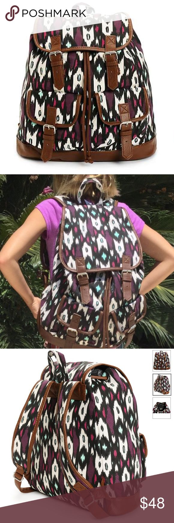 """Mint and Magenta print w Brown Trim Rucksack Mint and magenta canvas print with soft brown synthetic leather trim. Taffeta lining with cinch top and magnetic snap closures. Lightly padded shoulder straps with top handle loop. 14"""" H x 15"""" W x 6"""" D. 60% cotton, 40% polyester. NWT. Inside zippered pocket is big enough for your phone and keys. Outside pockets 6"""" H x 6""""W x 2"""" D. Bags Backpacks"""