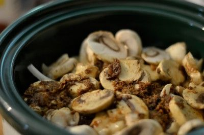 CROCKPOT STEAK AND MUSHROOMS   1 pkg (6-8 pc) cube steak  1 Onion, sliced  2 Cans Cream of Mushroom Soup    1 Cup Beef Broth  16 oz fresh mushrooms, sliced  ½ cup flour  ¼ tsp salt  ½ tsp pepper    2 TBSP olive oil  Sour Cream (optional)  Cooked noodles