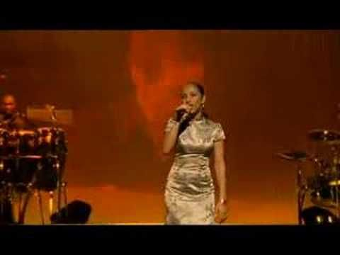 Sade  --  Style, beauty, grace and killing it onstage!