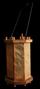 wood and parchment and iron handled lantern