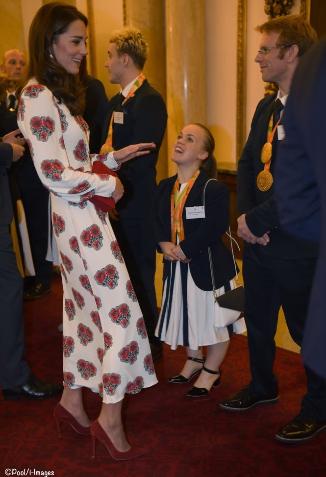Catherine, Duchess of Cambridge meets athletes during a reception for Team GB's Olympic and Paralympic athletes, hosted by Britain's Queen Elizabeth II, at Buckingham Palace on October 18, 2016.