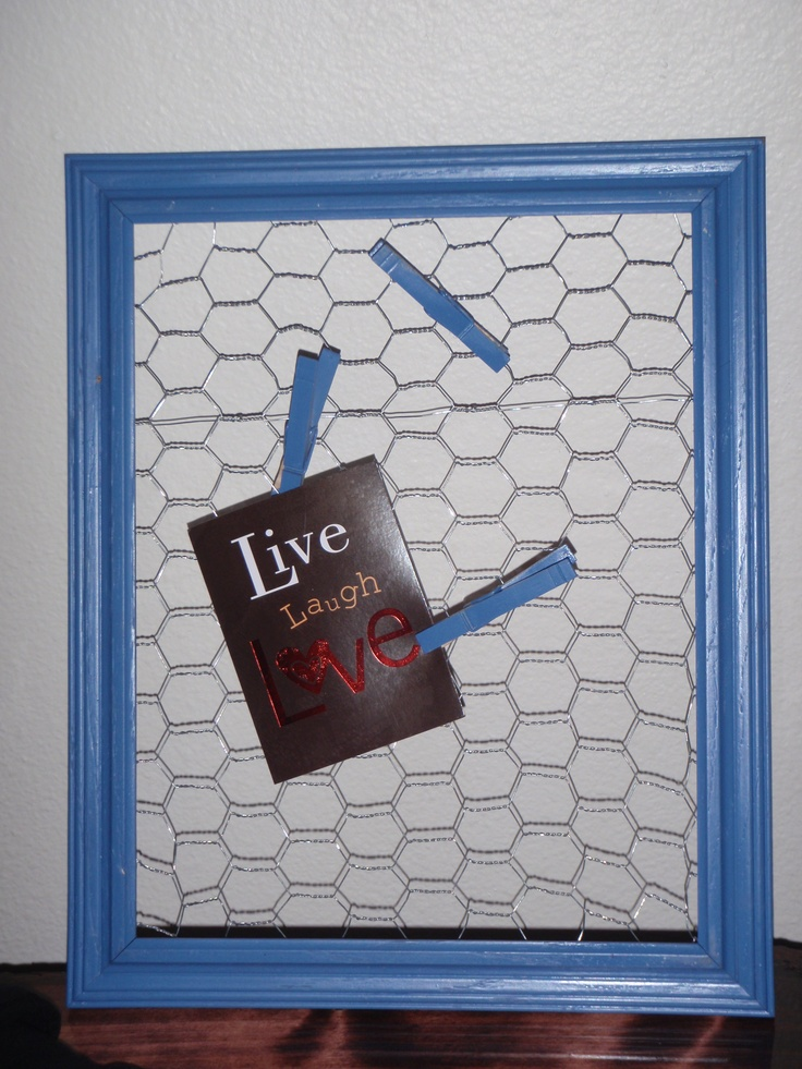 Old Picture frame + Spray Paint + Chicken Wire + Clothes pins = a cool little place to put pics or memos or cards or whatever...  :)