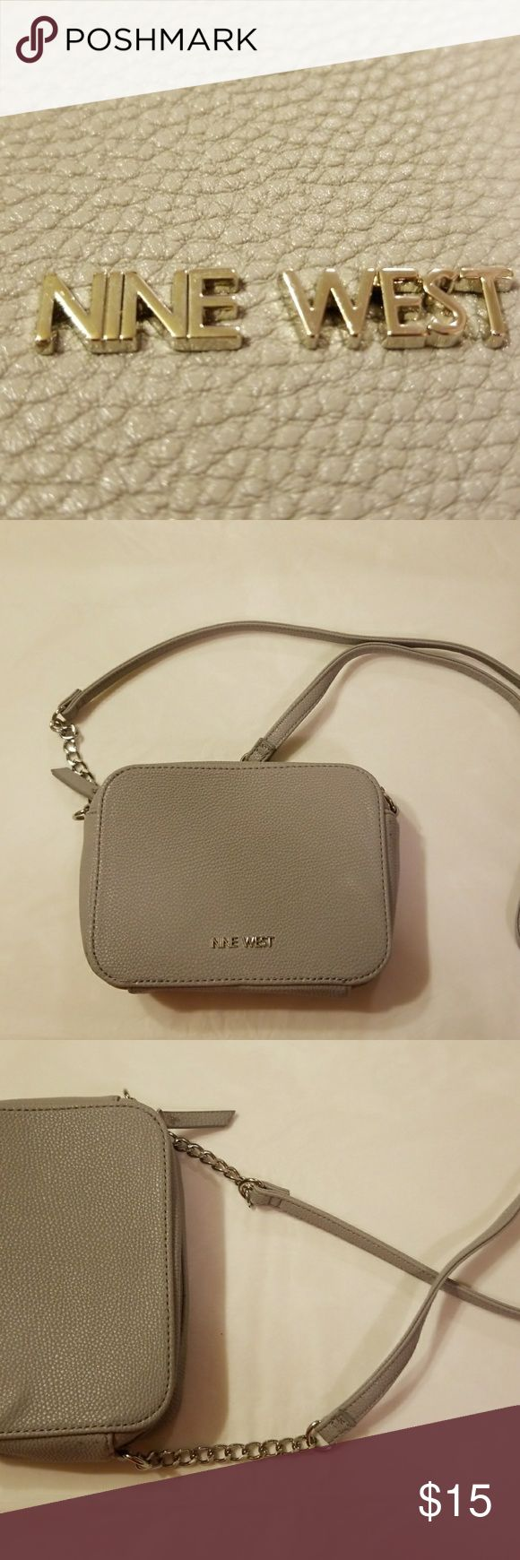 Dusty gray cross body Cute.. Can fit Samsung Galaxy 8plus and more.  Silver accent chains. Zipper closure.  Measurements : approx. 7 x 5 Flaw: little bubble in leather. Pic 4 black speckled spots. Came that way. Tried to show but you really can't tell. Unless up close scrutiny.  *Cute gray fur pom pom bag accessory,  available.  check closet Nine West Bags Crossbody Bags