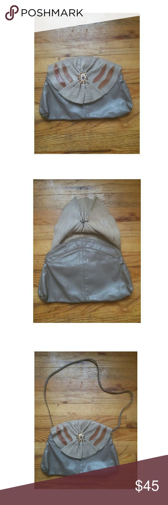 Vintage Leather/Suede Taupe Clutch/Purse -Vintage taupe color leather and suede clutch or shoulder strap bag  -Has a real seashell on front flap -Great for most occasions  -Pair with high-waisted jeans and a vintage tee-shirt for a more cool causal style. Bags Clutches & Wristlets