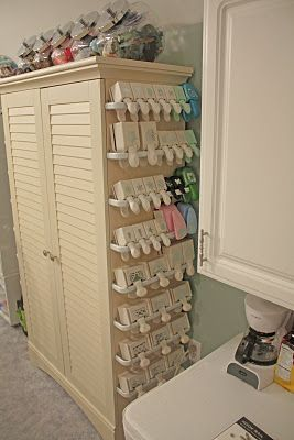 Craft punch storage ... be sure to scroll through all of the pictures of this amazing stamp studio [via @Stephanie Milner] I need this level of organization for my scrapbook room.