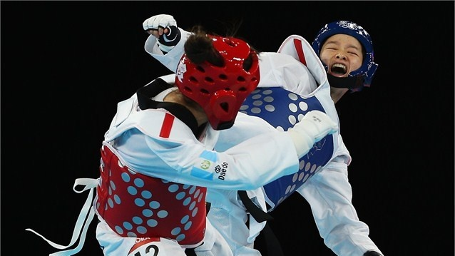 Wu Jungyu of China competes against Guatemala's Elizabeth Zamora Gordillo