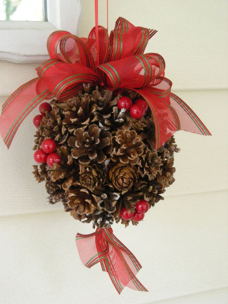 Pine Cone Kissing Ball - Might have to try this with hot glue and a wiffle ball. Really cute.