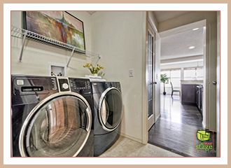Here is a home staging tip: Little additions make a big difference! With a few accessories we made this laundry room look inviting and enjoyable to use.