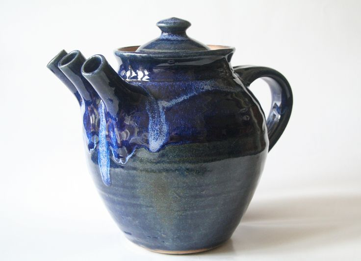 The Aylesford Teapot Name: Aylesford Teapot after DuChamp H: 19cm W: 15cm Material: Stoneware Maker: Alan Parris, Aylesford Pottery First shown at the Visit Kent 'Big Weekend' in March 2015  The three spouts represent the three elements of earth, water and air. Each essential to the harmony of creative thought, and an important factor in the traditional tea ceremony.