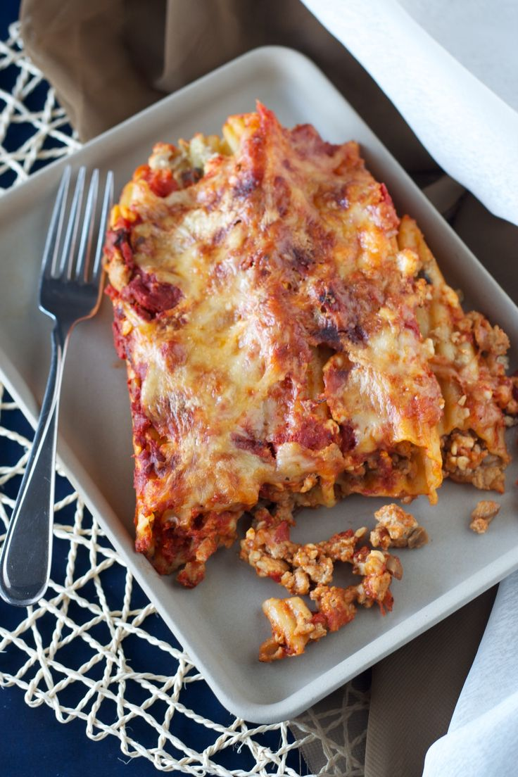 Turkey Manicotti - Amazing turkey manicotti - manicotti noodles filled with ground turkey in a mushroom cream sauce, and then smothered in tomato sauce and cheese and baked.