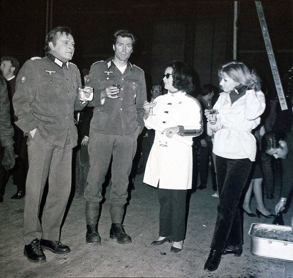 Richard Burton, Clint Eastwood, Elizabeth Taylor and Ingrid Pitt having a drink on the set of Where Eagles Dare.