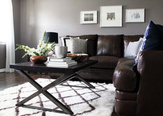 Modern, Industrial, and rustic retreat - grey walls with chocolate brown couch