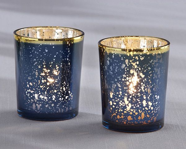 If elegance and romance are what you're looking for at your wedding, these beautiful navy tea light holders are adorned with a gold rim for an elegant touch to table decor