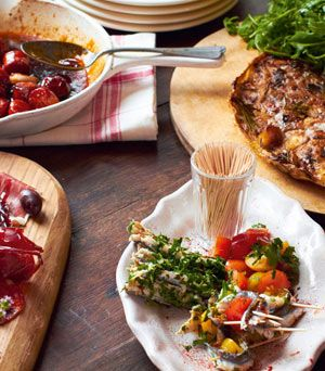 tapas feast: tortilla, glazed chorizo, manchego cheese, cured meats & honey, stuffed peppers, rolled anchovies | Jamie Oliver | Food | Jamie Oliver (UK)