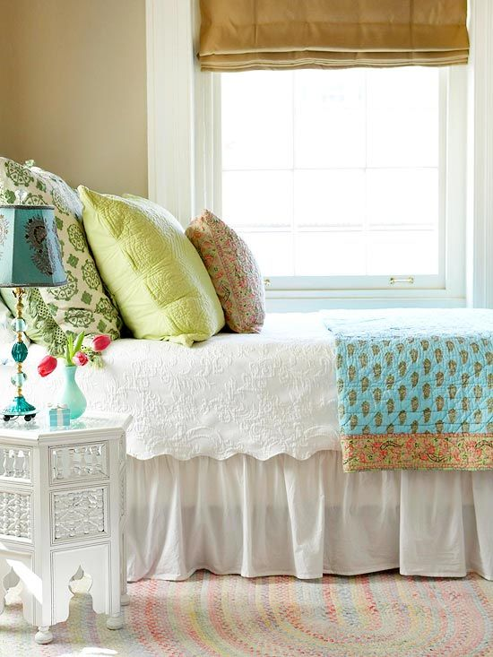 Bright pillows and a colorful throw add personality to this neutral space.