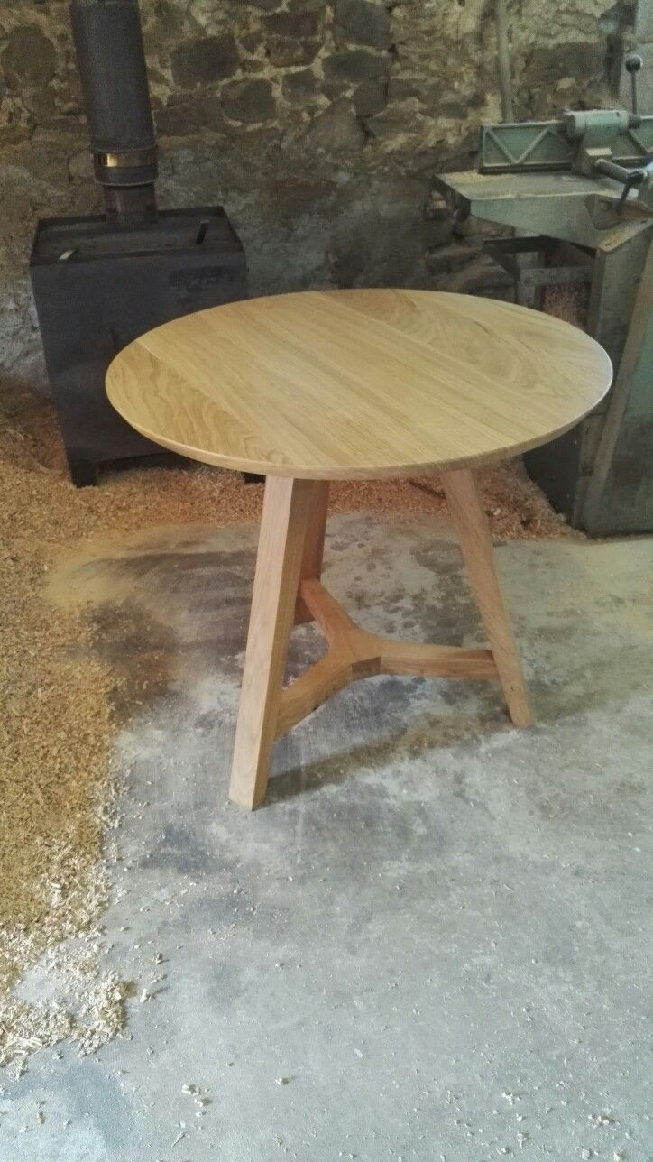 A small round oak dining table with tripod base. Handmade to order at www.makersbespokefurniture.com