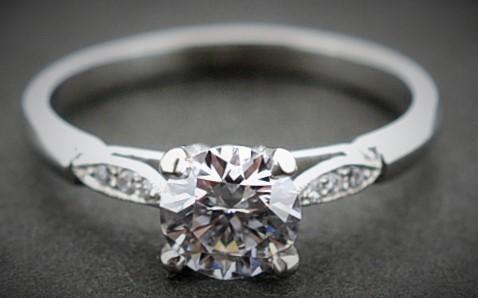 Round brilliant excellent cut diamond set in a fine Platinum mount with diamond petal  shoulders #Engagement #Diamonds #PlatinumCork