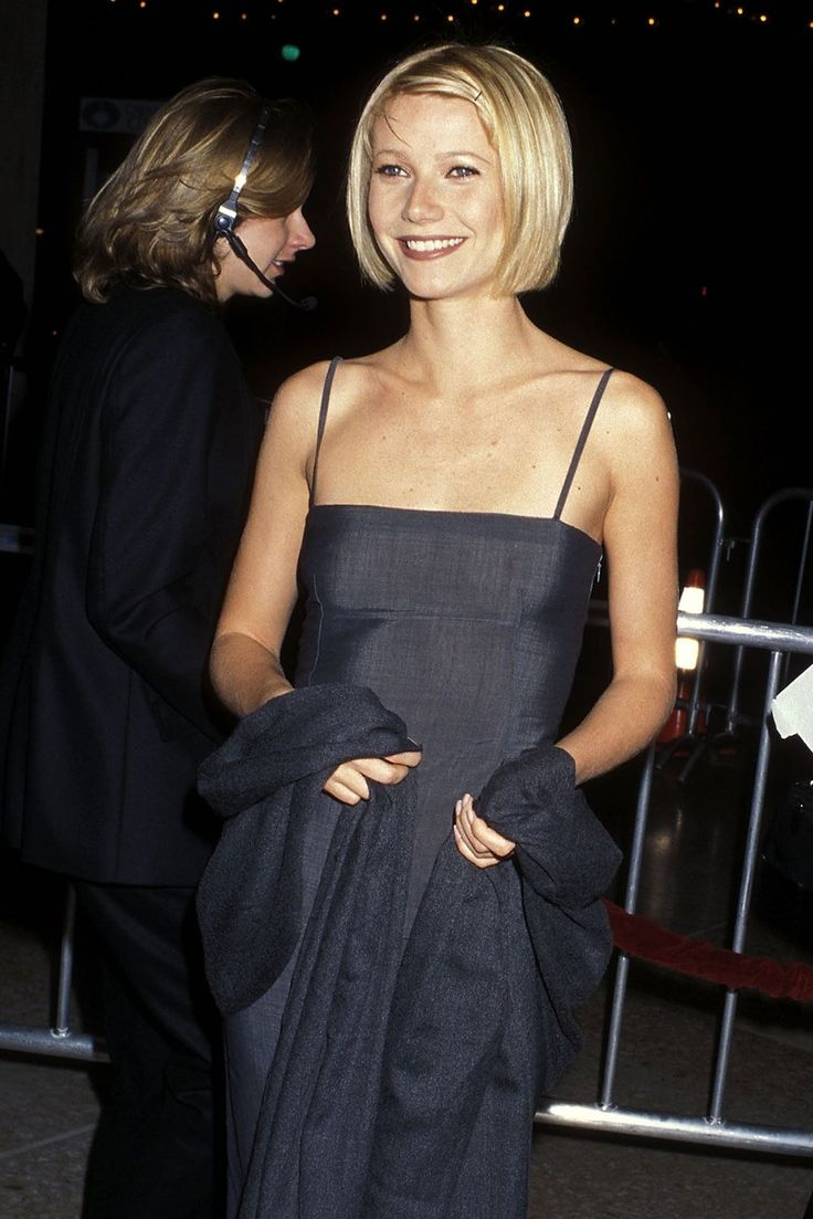 30+ Times '90s Gwyneth Paltrow Was Our Style Crush #refinery29  http://www.refinery29.com/2016/03/106619/gwyneth-paltrow-lookbook-throwback-90s-fashion#slide-14  Great Expectations Premiere, 1998This suit fabric spaghetti column dress is the kind of '90s minimalist piece that sends us into a crazed 10-hour binge on eBay, only to re-emerge having bought a Larry David badge. Gray never looked so good, right? We're a fan of the Cam Diaz 'do and visible bobby pins, as well....