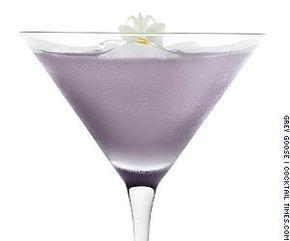 Black Orchid Ingredients: - 1 1/4 parts Grey Goose L'Orange vodka - 3/4 parts creme de violette - 3/4 parts lemon juice - 1/2 parts sim...