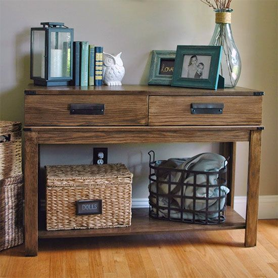 Custom built bin pulls, new stain and metal accents turned a $199.00 HomeGoods table into a West Elm Replica.