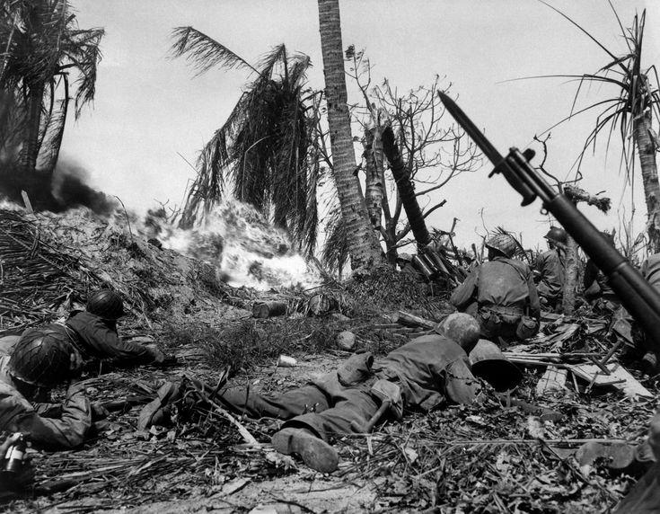 Soldiers of the U.S. 7th Infantry Division attack a Japanese blockhouse on Kwajalein. Kwajalein Atoll was invaded by the 5th Amphibious Fleet commanded by Rear Admiral Richmond K. Turner and the V Amphibious Fleet commanded by Major General Holland M. Smith from Jan - Feb, 1944. The 4th Marine Division would take the island of Roi-Namur along with surrounding small islets while the 7th Infantry Division would land on Kwajalein and other small islands of the atoll.