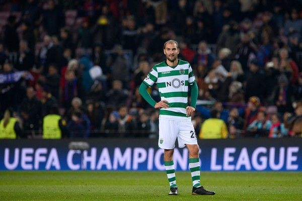 Sporting's Dutch forward Bas Dost reacts at the end of the UEFA Champions League football match FC Barcelona vs Sporting CP at the Camp Nou stadium in Barcelona on December 5, 2017. / AFP PHOTO / Josep LAGO