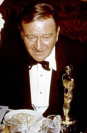 "2/23/14 11:53p The Academy Awards Ceremony 1970: John Wayne Best Actor Oscar for  ""True Grit""  1969  Academy Dinner   imdb.com"