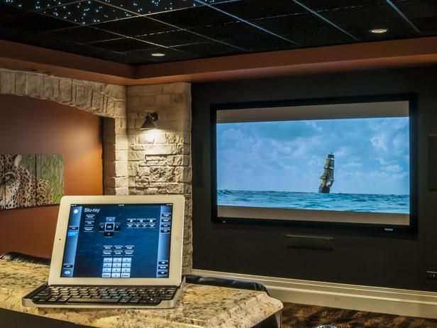 Crestron controls, with iPad compatibility, fully integrate control of both the a/v gear and lighting within this theater.