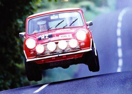 Mini Cooper Grabs Some Air. Contrary to some so-called experts, race cars go faster if their tires are actually touching the road.