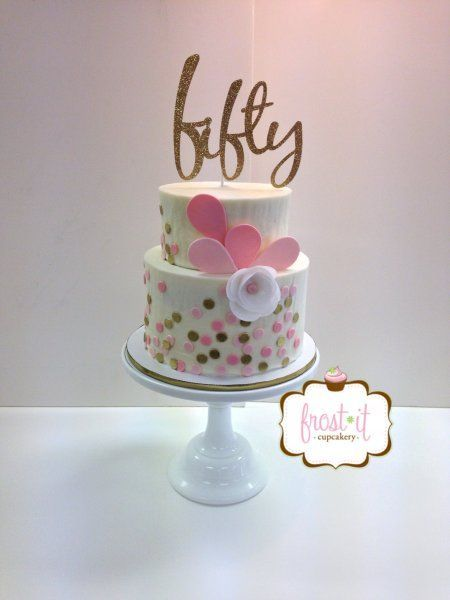 A 50th birthday cake idea for a woman that is contemporary and stylish.  See more 50th birthday cakes and party ideas at www.one-stop-party-ideas.com