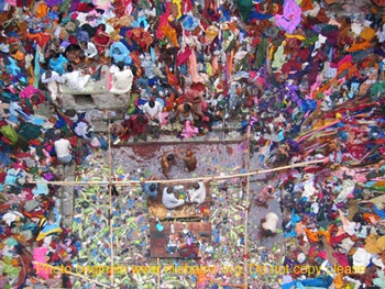 Lolarka Kund with the saris discarded on the steps after the people have bathed