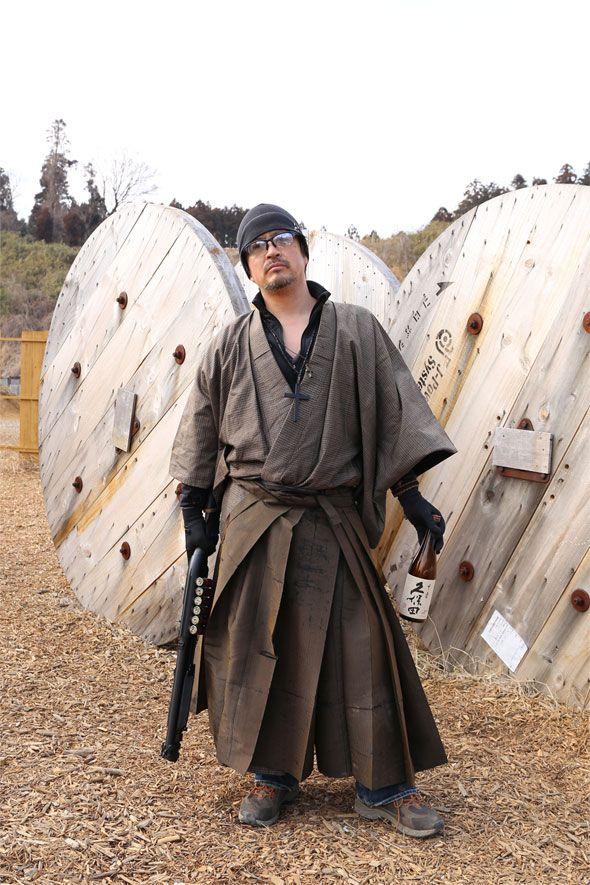 Airsoft Player in Japan. Fashion Photo. Kimono with Sake. Style Samurai. Military. Gun. Combat