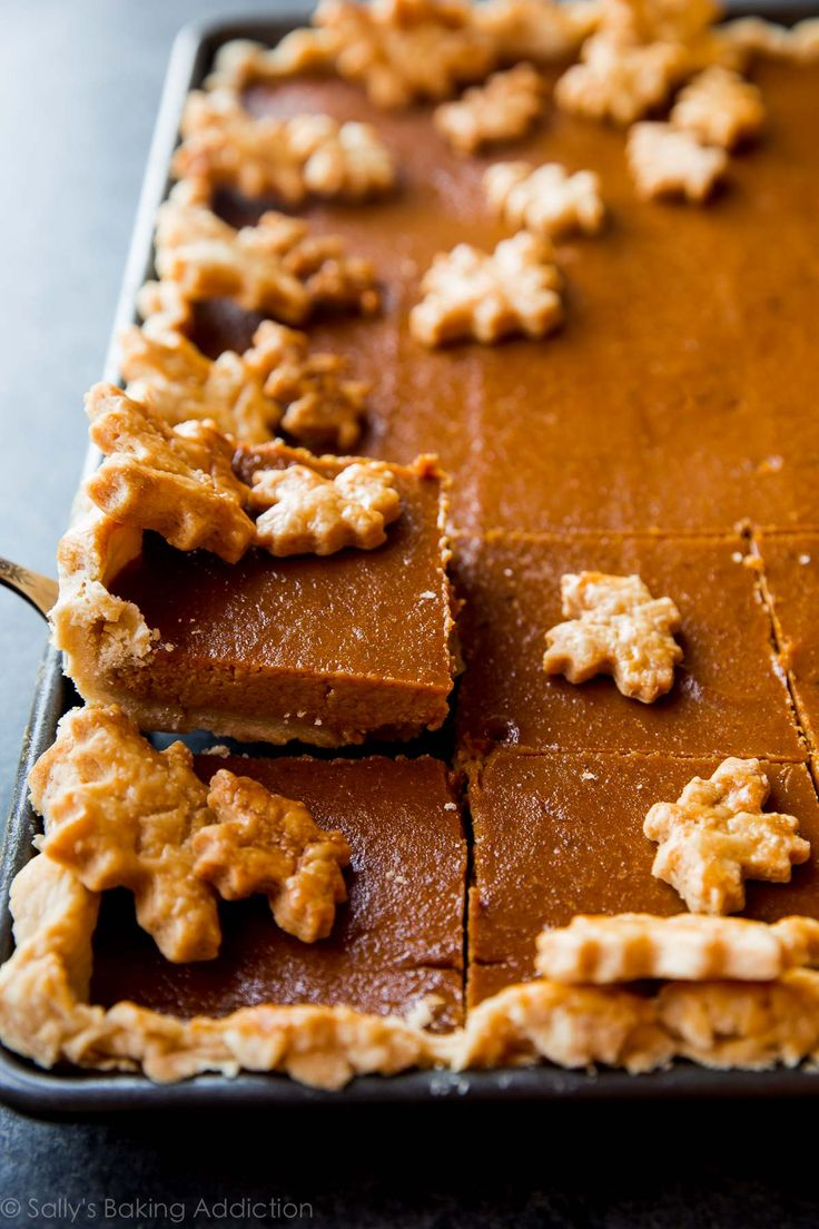 This pumpkin slab pie feeds a crowd. It's perfectly creamy and spiced with an ultra buttery flaky pie crust and a secret ingredient everyone loves!