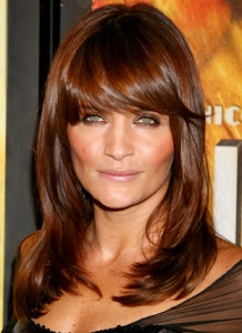 Top 5 Must-Try Spring Hair Trends - helena christensen with a thick side fringe....I love the color