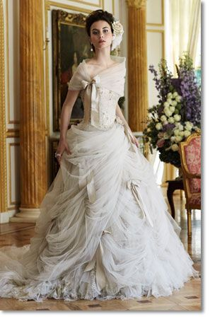 This beautiful draped bridal gown by Ian Stuart would be perfect for a Marie Antoinette themed wedding.
