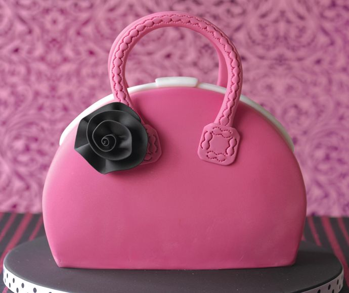 Here is my step by step tutorial for a Handbag cake. I made this cake for my sister's birthday, I don't think she'll appreciate if I ...
