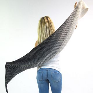 The SKEINO MOON SHAWL is knitted on the bias entirely in Garter Stitch. Increasing and decreasing stitches creates this diamond shape which is wide in the center and tips at the end. This makes it perfect to wear. Five single skeins are braided into this Knitting Kit. The colors are shading from light to dark or mirroring, making us think of the ever-changing moon.