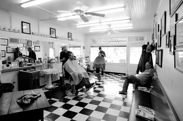 """Photo of the Day - May 9, 2012: """"Two barbers at South End Barber Shop cut hair. Everyone talks about high school football and local hunting spots."""" Aaron Cress (Salisbury, North Carlina)  Photographed January 2011, China Grove, North Carolina."""