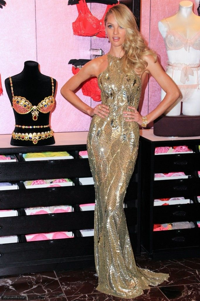 Candice Swanepoel reveals the Victoria's Secret Royal Fantasy Bra in Zuhair Murad dress.