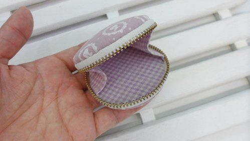 Zippered clam-shell style change purse.