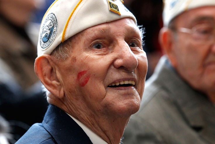 "Pearl Harbor survivor James Cook smiles after getting a kiss on the cheek from a member of the Andrews Sisters-styled group ""The Victory Belles"" at a ceremony observing the 70th anniversary of the attack on Pearl Harbor at the National World War II Museum in New Orleans, Louisiana, on December 7, 2011. (AP Photo/Gerald Herbert) #"