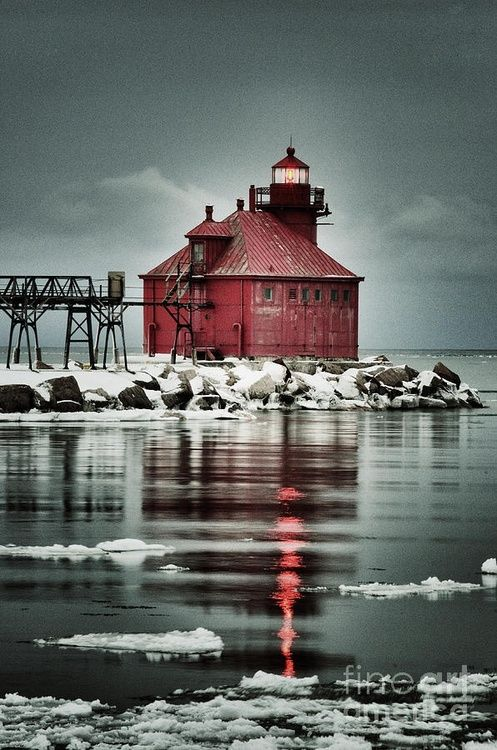 Lighthouse in Winter | The Sturgeon Bay Canal North Pierhead Light, located on the north pier of the southern entrance to the Sturgeon Bay Ship Canal, lights a path into Lake Michigan on an overcast, snowy March evening.