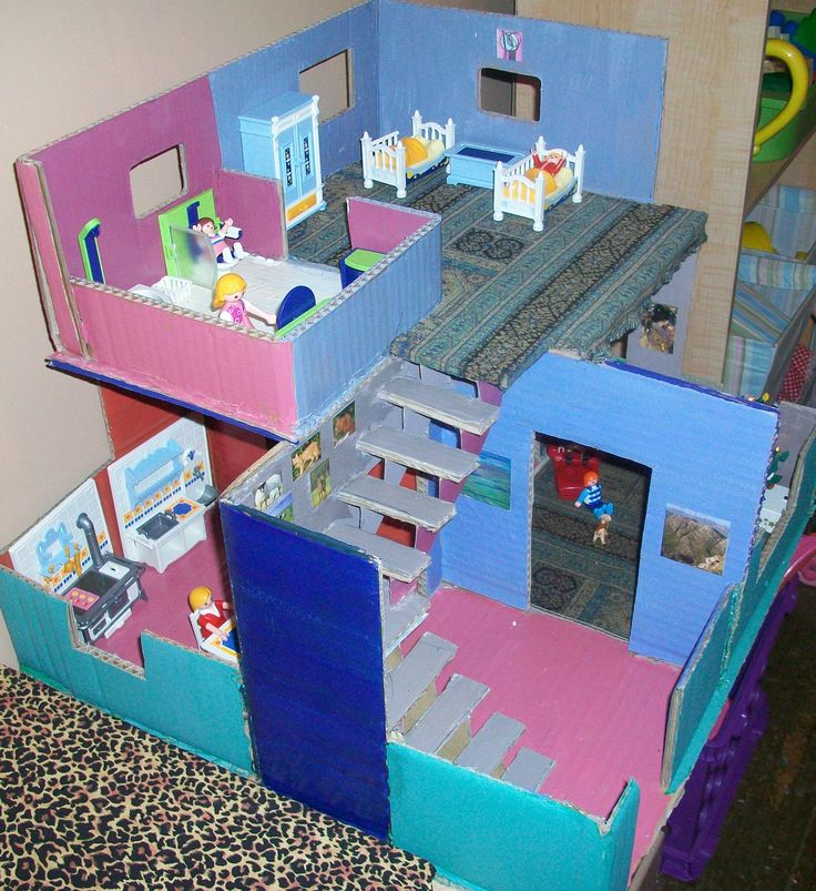 Dollhouse: Really neat cardboard house for Nessa, just the right size for her playmobil dolls. I made it from a television box.