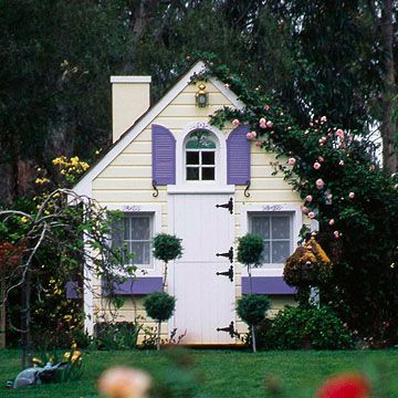 Afternoon Dreams   Perfect backyard playhouses  Plucked seemingly from the pages of a children's book, this pretty playhouse invites play with pops of color. Integrate a structure like this into a garden for even more outdoor impact; here, a vigorous climbing rose rambles over the roof